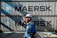 Electrical engineer Gissur Vestergaard on his rounds checking the power supply to the refrigerated containers (reefers) on the Mary Maersk, the largest container ship in the world.