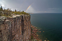 A rainbow appears during a thunderstorm at Palisade Head and Shovel Point in Tettegouche State Park on Minnesota North Shore.
