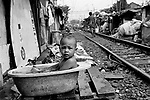 Senen, one of Jakarta's poorest areas. Here people live in illegally erected shacks precariously near fast moving trains.