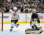 (Pittsburgh, PA, 06/01/13) Boston Bruins' Andrew Ference (21) celebrates a goal by teammate David Krejci past Pittsburgh Penguins goalie Tomas Vokoun during the first period of Game 1 of the NHL's Eastern Conference Finals at the Consol Energy Center on Saturday, June 01, 2013. Staff photo by Christopher Evans