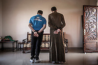 """Two """"shabihas"""" are exhibited at the house office of Yahya Alshekh Ameen, leader of the Islamic Scholars in Syria at Atmeh village. The two """"shabehas"""" are accused of unrevealed crimes, if they are found guilty they even might face the death penalty. For security reasons they are not allow to show their faces."""
