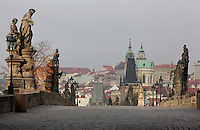 The Charles Bridge or Karluv most, built 1357 - 15th century, looking towards the Mala Strana or Lesser Quarter, across the Vltava river in Prague, Czech Republic. Its construction began under King Charles IV, replacing the old Judith Bridge built 1158'??1172 after flood damage in 1342. This new bridge was originally called the Stone Bridge (Kamenny most) or the Prague Bridge (Prazsky most) but has been the Charles Bridge since 1870. The bridge is 621m long and nearly 10m wide, resting on 16 arches shielded by ice guards. It is protected by three bridge towers, two on the Lesser Quarter side and one on the Old Town side. The historic centre of Prague was declared a UNESCO World Heritage Site in 1992. Picture by Manuel Cohen