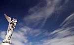 South America, Ecuador, Quito. The Virgin of Panecillo watches over the capitol of Ecuador against a blue sky.