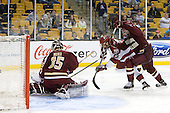 Parker Milner (BC - 35), Tommy O'Regan (Harvard - 13), Patrick Wey (BC - 6) - The Boston College Eagles defeated the Harvard University Crimson 4-1 in the opening round of the 2013 Beanpot tournament on Monday, February 4, 2013, at TD Garden in Boston, Massachusetts.