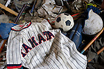 A basebll jersey and soccer ball lie among the debris inside the city sports center in Rikuzentakata City, Iwate Prefecture, Japan on 11 Mar. 2012.  Hundreds of people paid their respects at the center following  a remembrance service held nearby to mark the one year anniversary of last year's magnitude 9 earthquake and tsunamis in Japan's northeast..Photographer: Robert Gilhooly