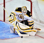 24 September 2009: Boston Bruins' goaltender Tim Thomas makes a second period save against the Montreal Canadiens at the Bell Centre in Montreal, Quebec, Canada. The Bruins defeated the Canadiens 2-1 in an overtime shootout. Mandatory Photo Credit: Ed Wolfstein Photo