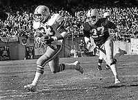 Dallas Cowboy running back Tony Dorsett scores TD chased by Oakland Raiders Lester Hayes. (1980 photo by Ron Riesterer)