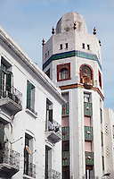 The La Equitativa building in the Ensanche or Spanish Expansion area of Tetouan, built in the early 20th century during the time of the Spanish Protectorate of Morocco. After the Reconquest of Spain, Tetouan was rebuilt by Andalusian refugees who had been expelled by the Spanish, and the town continued to have a strong Moorish influence in its art and architecture. Picture by Manuel Cohen