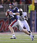 Mississippi quarterback Bo Wallace (14) is chased by Vanderbilt defensive back Andre Hal (23) at Vaught-Hemingway Stadium in Oxford, Miss. on Saturday, November 10, 2012. (AP Photo/Oxford Eagle, Bruce Newman)