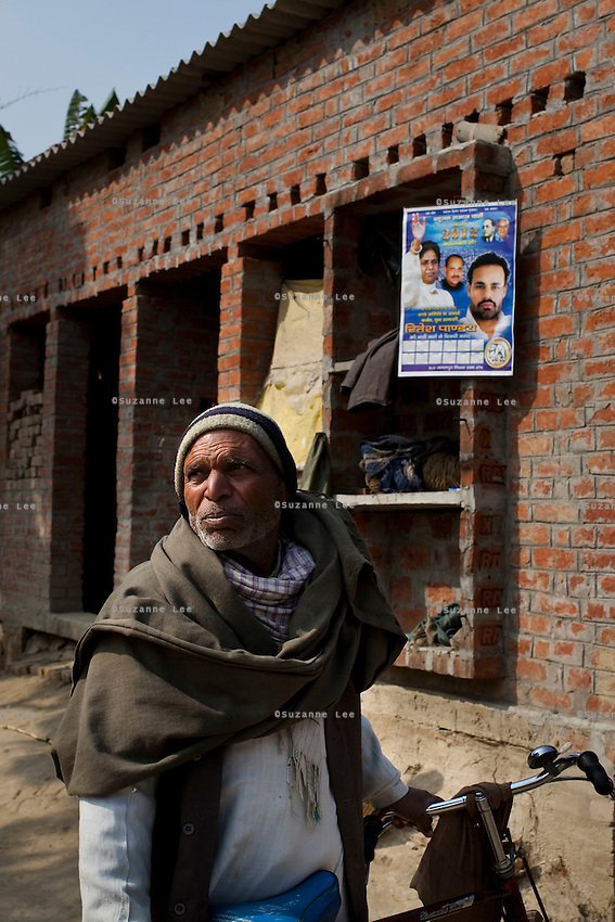 A party calendar of BSP Minister of Legislative Assembly, Ritesh Pandey, 30, is seen hung on the wall in Ajanpara village, Ambedkar Nagar, Uttar Pradesh, India, on 21st January, 2012. Returning 1.5 years ago after almost 10 years abroad, Pandey is contesting on behalf of the Bahujan Samaj Party (BSP), a party that is based on its appeal to Dalit voters. Party leader Mayawati, herself a Dalit, has recently been giving out more tickets to muslims and high caste candidates in an attempt to woo a larger spectrum of voters in Uttar Pradesh, a Bellwether state. Photo by Suzanne Lee for The National (online byline: Photo by Szu for The National)