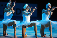 "(L-R) Yana Lukonina, Daria Dmitrieva, Diana Botsieva of Russia (juniors) perform elements of swan ballet during gala exhibition with combined Russian group at 2008 European Championships at Torino, Italy on June 7, 2008.  Photo by Tom Theobald.Photo note: This is blue light version, full spectrum arena lights came on immediately after this image on next frame (see earlier version ""3104-rus-jrs..."")."