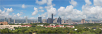 On a September afternoon, soft white clouds drift over the Austin skyline and downtown in the capitol city of Texas. This panorama is made up of three images stitched together. Primonently displayed is the Austonian, the tallest building in Austin (currently). Peaking over a few skyscrapers is the iconic Frost Tower. <br />