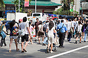 Pedestrians at crosswalk on the Orchard Road in Singapore.