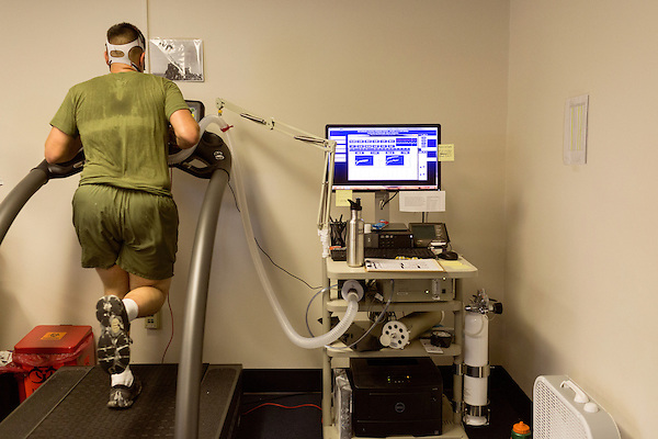 October 21, 2014. Camp LeJeune, North Carolina.<br />  LCpl. Eduardo Arenas Matos, age 20, runs on a treadmill as research assistants of the University of Pittsburgh measure his oxygen and blood lactate levels. Levels are rechecked throughout the test to see how the Marine's body processes lactate and oxygen under physical stress.<br />  The Ground Combat Element Integrated Task Force is a battalion level unit created in an effort to assess Marines in a series of physical and medical tests to establish baseline standards as the Corps analyze the best way to possibly integrate female Marines into combat arms occupational specialities, such as infantry personnel, for which they were previously not eligible. The unit will be comprised of approx. 650 Marines in total, with about 400 of those being volunteers, both male and female. <br />  Jeremy M. Lange for the Wall Street Journal<br /> COED