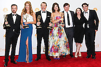 LOS ANGELES, CA, USA - AUGUST 25: Actors Aaron Paul, Anna Gunn, Bryan Cranston, Betsy Brandt, Jesse Plemons, Laura Fraser and RJ Mitte, winners of Outstanding Drama Series Award, Outstanding Lead Actor in a Drama Series Award, Outstanding Supporting Actor in a Drama Series Award, Outstanding Supporting Actress in a Drama Series and Outstanding Writing for a Drama Series for 'Breaking Bad', pose in the press room at the 66th Annual Primetime Emmy Awards held at Nokia Theatre L.A. Live on August 25, 2014 in Los Angeles, California, United States. (Photo by Celebrity Monitor)