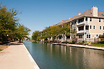 USA, Indiana, Indianapolis, tree-lined canal in downtown area with architectural features and housing..