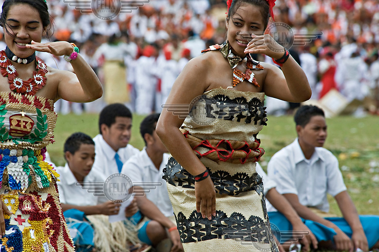 Young women perform the siva, a traditional Polynesian dance, at the Education and Cultural Day on the first day of official celebrations marking the coronation of George Tupou V.