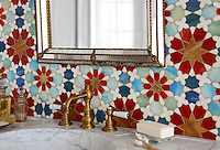 Granada Grande, a jewel glass waterjet mosaic shown in Gold Glass, Tiger's Eye, Garnet, Peacock Topaz, Quartz, and Aquamarine, is part of the Miraflores Collection by Paul Schatz for New Ravenna Mosaics.