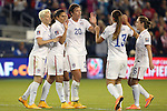 15 October 2014: Abby Wambach (USA) (20) celebrates her goal with (from left) Megan Rapinoe (USA), Carli Lloyd (USA), Alex Morgan (USA), and Meghan Klingenberg (USA). The United States Women's National Team played the Trinidad and Tobago Women's National Team at Sporting Park in Kansas City, Kansas in a 2014 CONCACAF Women's Championship Group A game, which serves as a qualifying tournament for the 2015 FIFA Women's World Cup in Canada. The United States won the game 1-0.