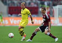 FUSSBALL   1. BUNDESLIGA  SAISON 2012/2013   2. Spieltag 1. FC Nuernberg - Borussia Dortmund       01.09.2012 Mario Goetze (li, Borussia Dortmund) gegen Timmy Simons (1 FC Nuernberg)