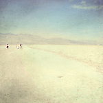 a little group of people in the sand of the death valley