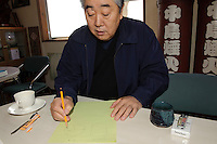 "CEO Masanori Honda draws a diagram showing Japanese and Western style fireworks at Katakai Fireworks Co., Ltd, Katakai, Japan, April 7, 2009. The company makes the world's largest firework, a 120cm round shell called a ""yonshakudama""."