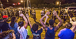 "BATON ROUGE, LA -JULY 10: Protesters shout ""Hand up, don't shoot"" as law enforcement gather before charging the protesters to make arrest on July 10, 2016 in Baton Rouge, Louisiana. Alton Sterling was shot by a police officer in front of the Triple S Food Mart in Baton Rouge on July 5th, leading the Department of Justice to open a civil rights investigation. (Photo by Mark Wallheiser/Getty Images)"