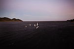"""A flock of birds takes off at dusk in Pueblo Viejo de San Dionisio...The Isthmus of Tehuantapec, long a center for indigenous land ownership, is now embroiled in a land dispute over wind farm land...Called """"Mexico's little waist,"""" the Isthmus is a wind tunnel that links the Gulf of Mexico to the Pacific through mountain passes at the narrowest part of Mexico. The geographical funnel makes it one of the windiest places in North America and for a decade wind energy companies have been jostling to acquire land to power the likes of Coca-Cola and Wal Mart."""