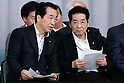 June 28th, 2011, Tokyo, Japan - Beleaguered Japanese Prime Minister Naoto Kan, left, talks to party senior Yoshito Sengoku  as the ruling Democratic Party of Japan calls on a general assembly of its members at the Diet in Tokyo on Tuesday, June 28, 2011. Defining for the first time conditions for fulfilling his June 2 pledge to resign, Kan said on Monday he would resign after the passage of three key bills - the second reconstruction budget, the renewable energy bill and the bond-issuance bill. Kan has been under pressure from both the opposition and his own Democratic Party of Japan to step down over his poor handling of the March 11 earthquake and tsunami that caused the biggest nuclear catastrophe in 25 years. (Photo by AFLO) [3609] -mis-...