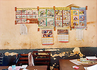 Posters on a wall in the office of the Anti-Corruption, Economic and Narcotic Squad in Kakira Police Station.