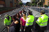 BOGOTA, Colombia. 13th June 2014. People wait in line to cast their votes during the runoff for presidential elections in Bogota, Colombia. Photo by Eduardo Munoz Alvarez/VIEWpress