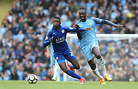Leicester City's Wilfred Ndidi and Manchester City's Yaya Toure<br /> <br /> Photographer Stephen White/CameraSport<br /> <br /> The Premier League - Manchester City v Leicester City - Saturday 13th May 2017 - Etihad Stadium - Manchester<br /> <br /> World Copyright &copy; 2017 CameraSport. All rights reserved. 43 Linden Ave. Countesthorpe. Leicester. England. LE8 5PG - Tel: +44 (0) 116 277 4147 - admin@camerasport.com - www.camerasport.com