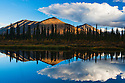 Reflection of Ogilvie Mountains in small lake, northern Yukon