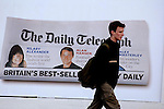 JAMES BOARDMAN / 07967642437 - 01444 412089 .A pedestrian walks past a Daily Telegraph advertisment, Hollinger Inc the owner of the Daily Telegraph are selling the company.. .