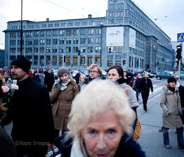 WARSAW, POLAND, NOVEMBER 2011:.Wika Szmyt, 74 year old DJ is standing at the tram stop in central Warsaw, surrounded by young people..Wika is famous in Poland for being the oldest DJ. Twice a week she runs discos at the Bolek club in Warsaw, frequented mainly by the pensioners..(Photo by Piotr Malecki/Napo Images)..WARSZAWA, LISTOPAD 2011:.Wika Szmyt, 74-letnia DJ stoi na przystanku wsrod mlodych ludzi. Wika jest znana jako najstarsza didzejka w Polsce. Dwa razy w tygodniu prowadzi dyskoteki w klubie Bolek, na ktore przychodza glownie emeryci..Fot: Piotr Malecki/Napo Images.***ZAKAZ PUBLIKACJI W TABLOIDACH I PORTALACH PLOTKARSKICH*** .*** Zdjecie moze byc uzyte w prasie, gdy sposob jego wykorzystania oraz podpis nie obrazaja osob znajdujacych sie na fotografii ***.