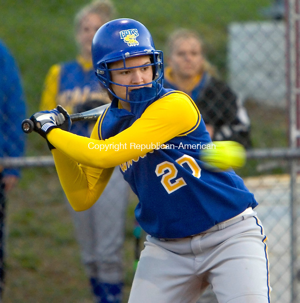 WOLCOTT, CT --MAY 22, 2008-052208JS02-Seymour's Alyssa Downs (20) watches the ball while at bat during their NVL semi-final game against Watertown Thursday at Wolcott High School. Downs will bite down on her uniform while batting. <br /> Jim Shannon/Republican-American