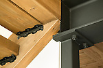 Detail of metal beam and wood stairs in a contemporary home. This image is available through an alternate architectural stock image agency, Collinstock located here: http://www.collinstock.com