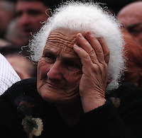 A lady listens intently to the speeches given in Tbilisi at the Anti-Saakashvili rallies in May 2009