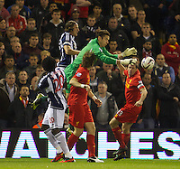 WEST BROMWICH, ENGLAND - Wednesday, September 26, 2012: Liverpool's goalkeeper Brad Jones is fouled by West Bromwich Albion's Jonas Olsson in the build up to the opening goal during the Football League Cup 3rd Round match at the Hawthorns. (Pic by David Rawcliffe/Propaganda)