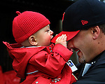 "Harrison ""Laz"" Glickman , 9 mos., takes a bite out of his dad Marshall Glickman's hat during the opening ceremonies at PGE Park in Portland."