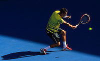 Bernard Tomic of Australia returns to Sergiy Stakhovsky of Ukranie during their semi-final match at the Sydney International tennis tournament, Jan. 10, 2014.  Daniel Munoz/Viewpress IMAGE RESTRICTED TO EDITORIAL USE ONLY