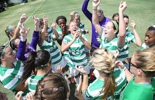DENTON, TX- AUGUST 25:Tori Adame, Haley Riley and Jackie Kerestine #0 of the North Texas Mean Green and team - Houston Baptist vs North Texas Mean Green Soccer team at Mean Green Village Soccer Field in Denton on August 25, 2013 in Denton, Texas. Photo by Rick Yeatts