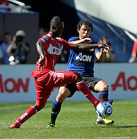 Manchester United defender Fabio da Silva (20) pressures Chicago Fire midfielder Patrick Nyarko (14).  Manchester United defeated the Chicago Fire 3-1 at Soldier Field in Chicago, IL on July 23, 2011.