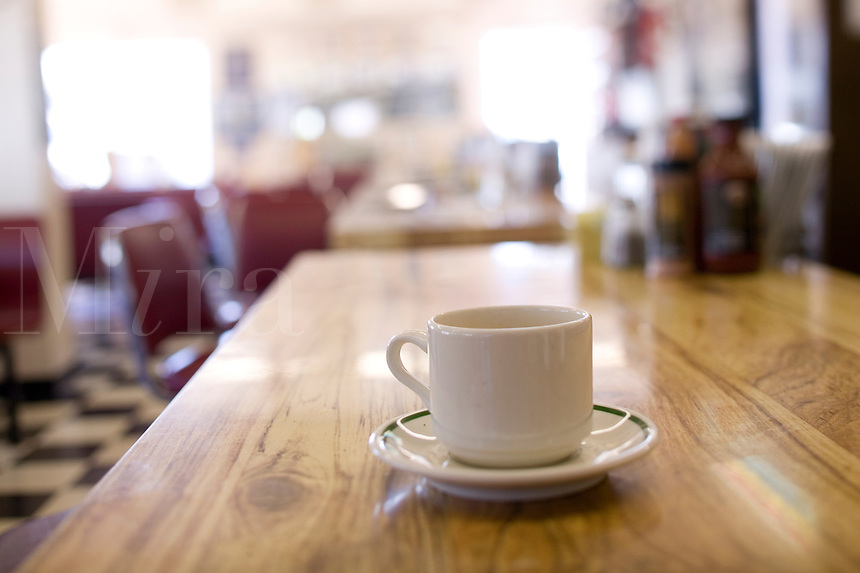 Cup of coffee on the bar of a diner, Bar BQ restaurant