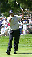 """Tiger Woods reacts after sinking a put during the 2000 U.S. Open in Pebble Beach in Monterey, California, USA. In the 2000 U.S. Open, Woods broke or tied a total of nine U.S. Open records with his 15-shot win, including Old Tom Morris's record for the largest victory margin ever in a major championship, which had stood since 1862, and became the Tour's all-time career money leader. He led by a record 10 strokes going into the final round, and Sports Illustrated called it """"the greatest performance in golf history."""" (Photo by Alan Greth)"""