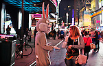 NewYork, United States, October 07, 2011..A man dressed as &quot;Bugs Bunny&quot; ask for money after posing for a picture in Times Square in central Manhattan New York October 7, 2011. VIEWpress / Kena Betancur. .On the 20th day of the &ldquo;Occupy Wall Street&rdquo; protest, Mayor Michael Bloomberg weighed in on the movement. He mostly criticized the group and said their actions are hurting the economy and tourism sector..Local Media Report.