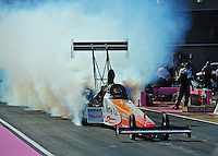 Oct. 30, 2011; Las Vegas, NV, USA: NHRA top fuel dragster driver Clay Millican during the Big O Tires Nationals at The Strip at Las Vegas Motor Speedway. Mandatory Credit: Mark J. Rebilas-