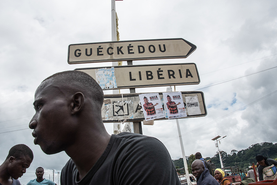 Macenta, Guinea (July 29, 2016) - Signs in Macenta, Guinea point toward Gueckedou, Guinea and the Liberia border. The Ebola outbreak is believed to have begun in December 2013 in Meliandou, Guinea just outside of Gueckedou and then spread to neighboring Liberia and Sierra Leone.
