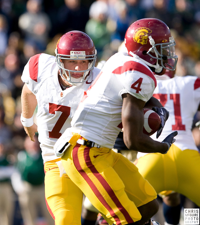 10/17/09 - South Bend, IN:  USC quarterback Matt Barkley hands off to running back Joe McKnight during the first quarter at Notre Dame Stadium on Saturday.  USC won the game 34-27 to extend its win streak over Notre Dame to 8 games.  Photo by Christopher McGuire.
