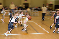 young boys play in a church league basketball game, Richmond, VA, USA